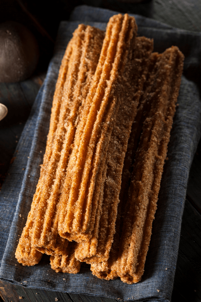 churros on a grey towel