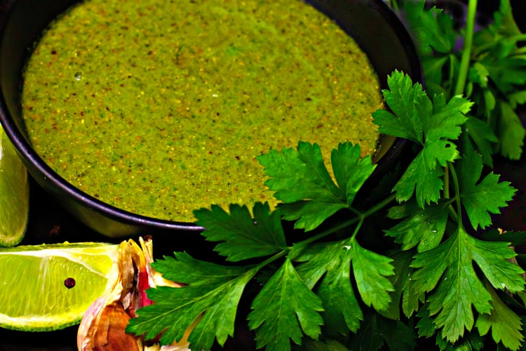 Green curry paste in a black bowl