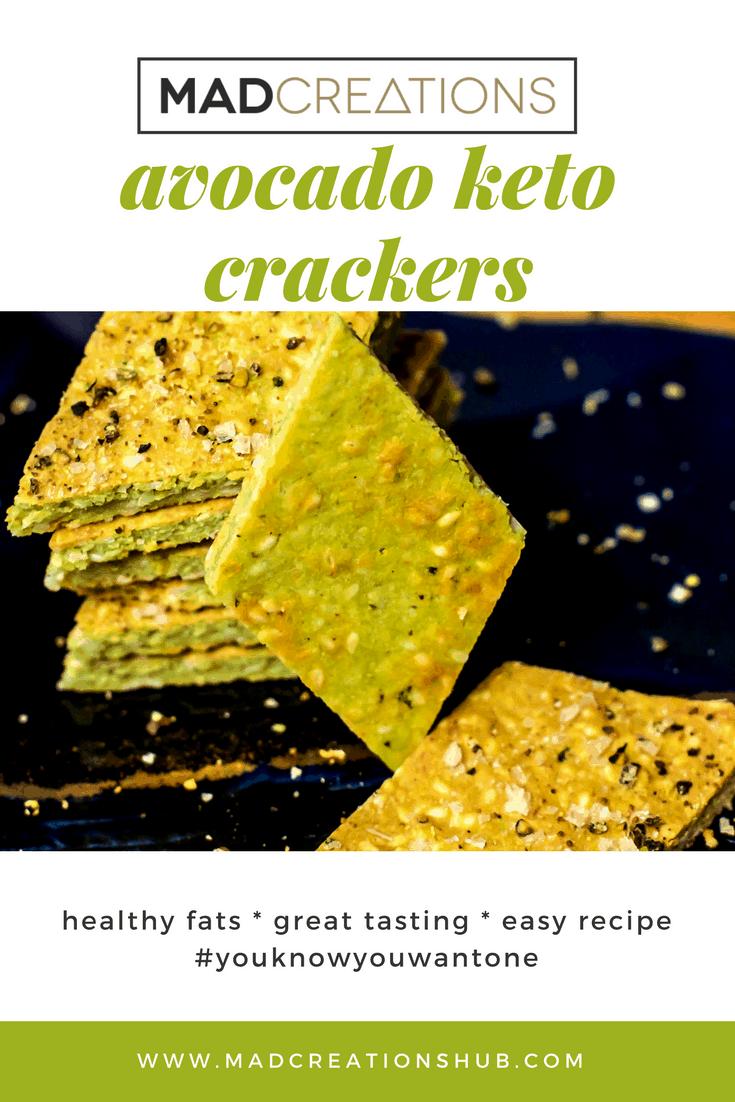 Avocado keto crackers on a black plate