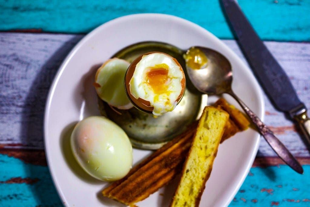3 cheese churros with soft boiled egg on plate
