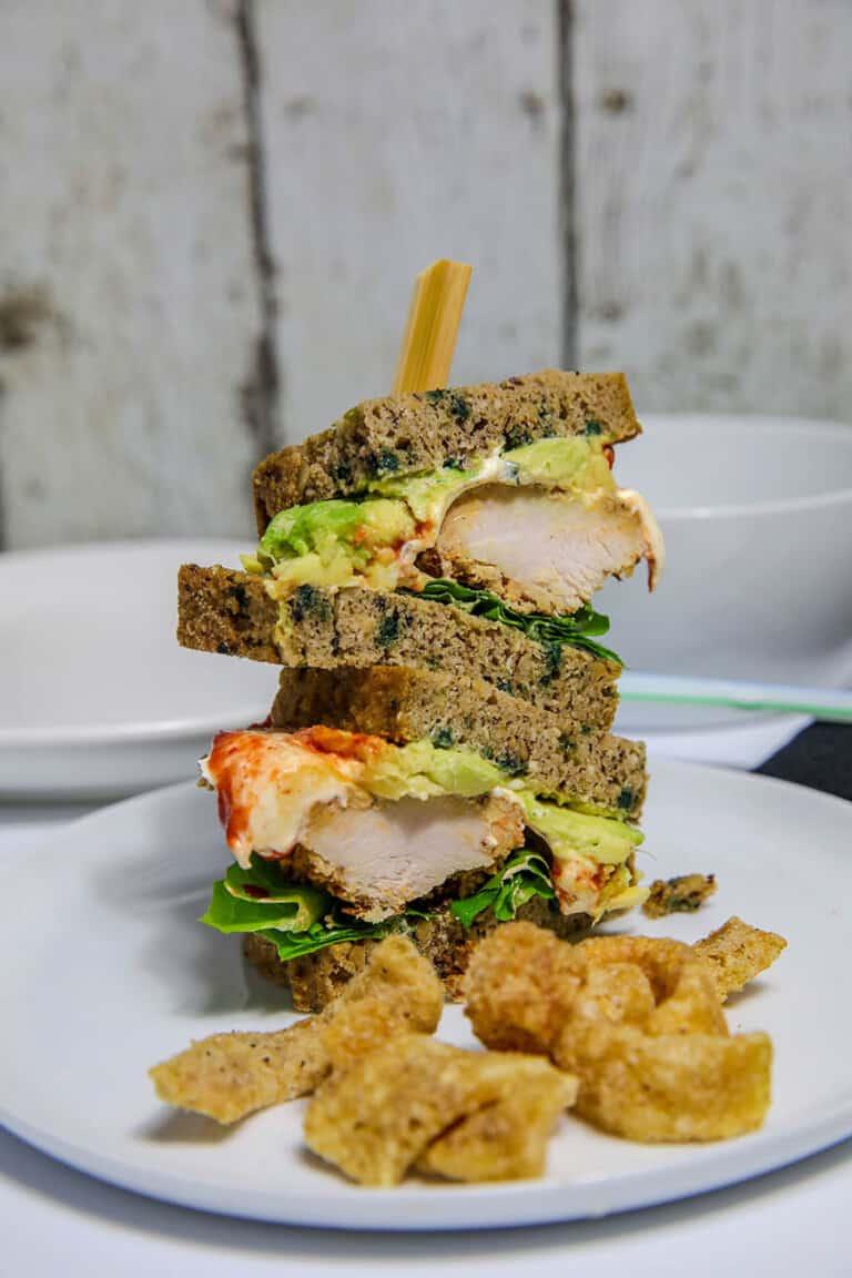 a sandwich cut in half with pork rinds