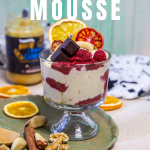 mousse with chocolate and berries in a small glass bowl