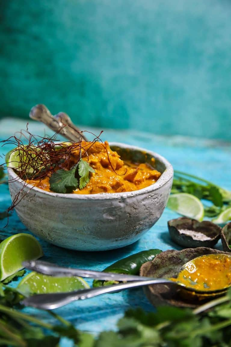 bowl of korma on green background