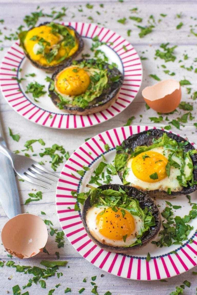 eggs in mushrooms on two plates