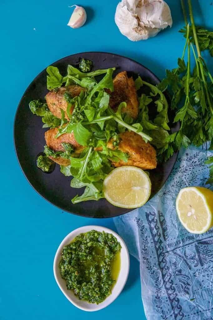 Mad Creations Seasoned King Fish with bowl of lemon gremolata