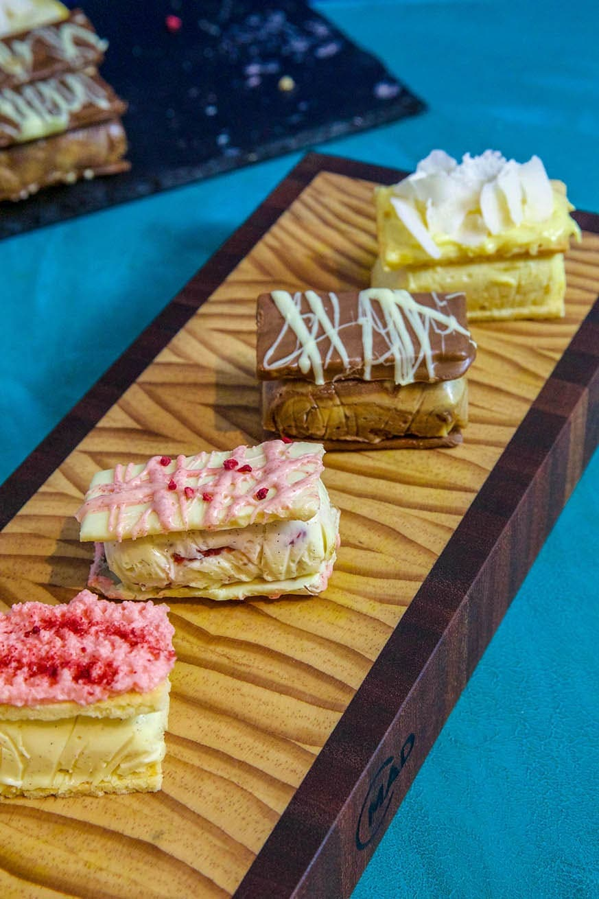 Mad Creations varieties of sugar free Vanilla Slice on a cutting board