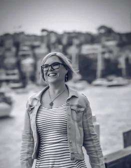 Girl in black and white stripe dress