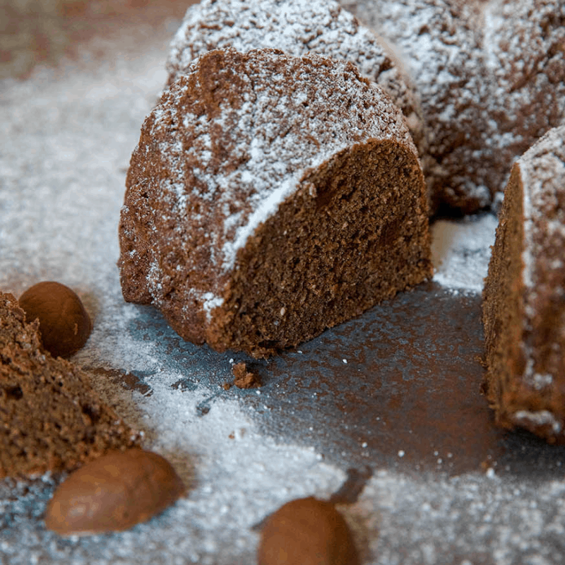 Sweet keto spiced bundt with a piece out of it