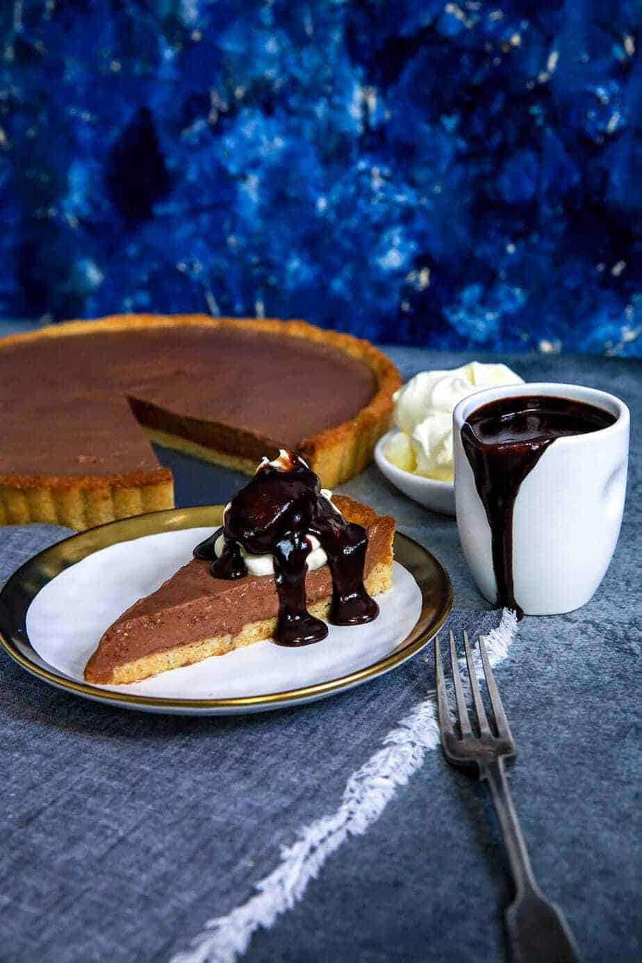 Bavarian pie with chocolate sauce on a plate