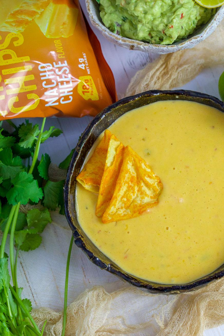 Cheese Dip in a bowl with coriander and protein chips