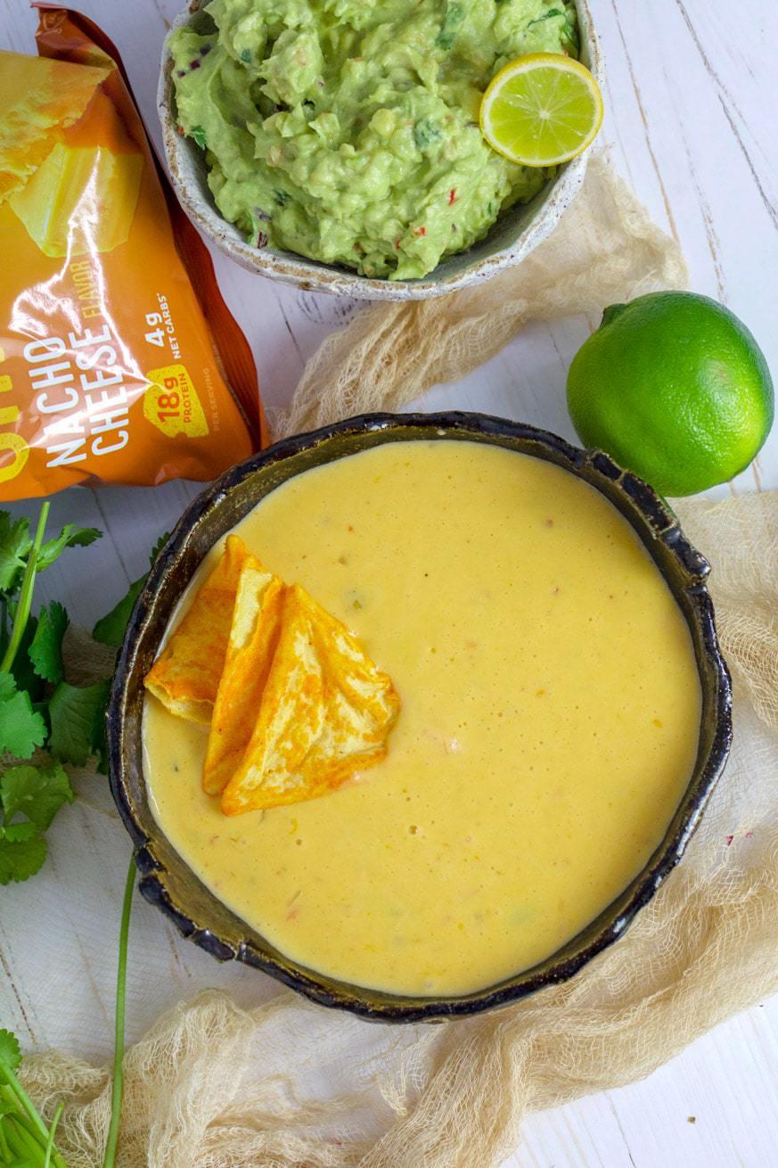 Chile con queso in a black bowl