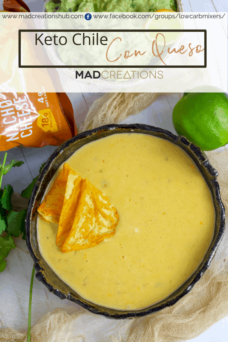 Chile Con Queso in a black bowl with protein chips