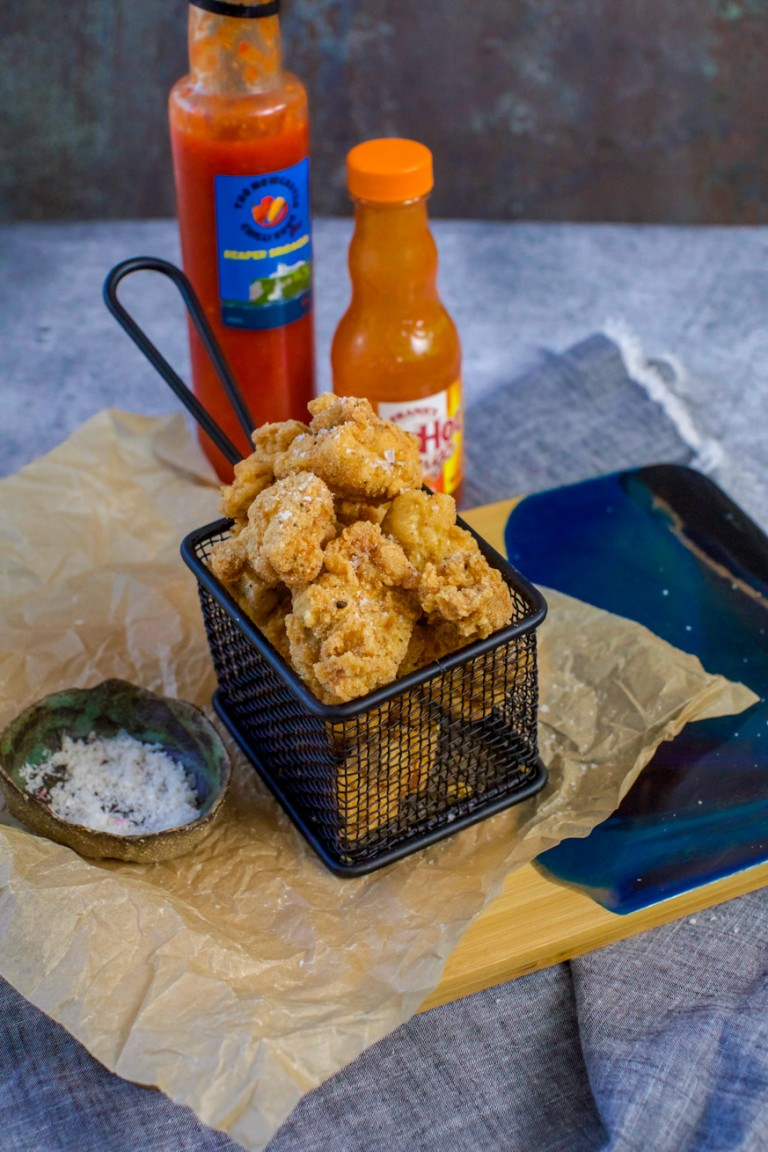 Fried piece of chicken in a mini fry basket
