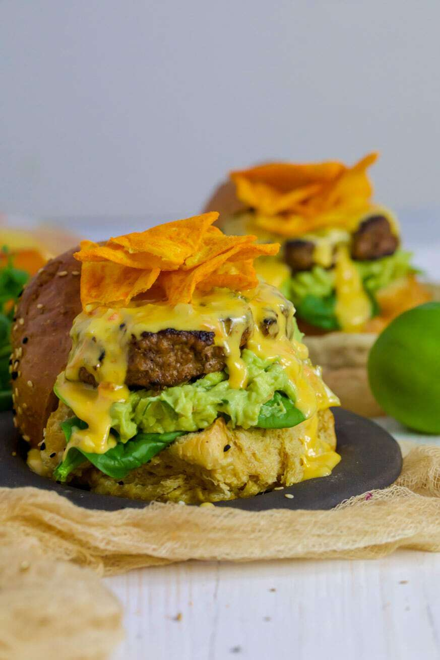 Mad Creations Mexican Keto Beef Burger with con queso on a black plate