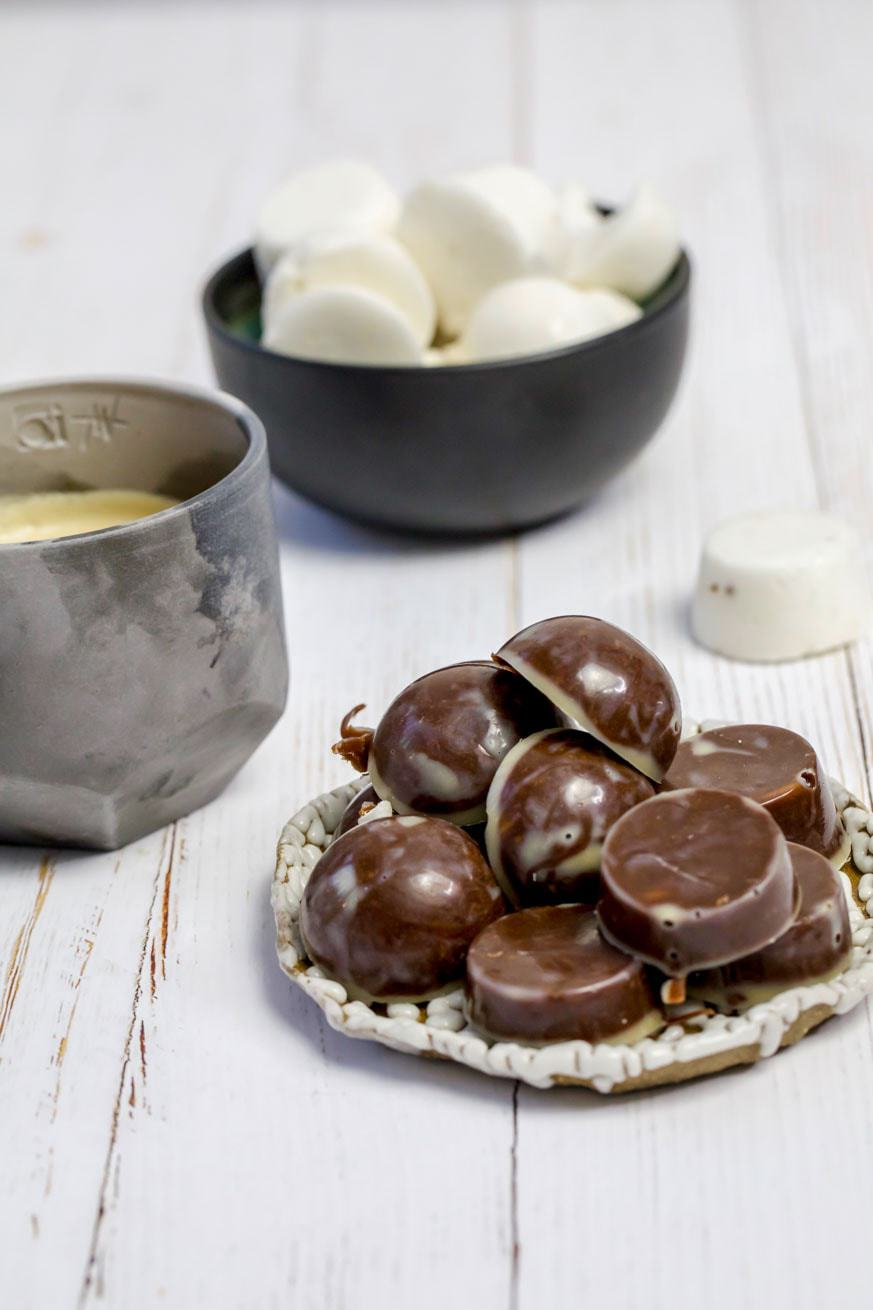 chocolate fat bombs marshmallows and coffee in bowls