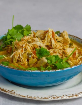 Instant Pot Mexican Shredded Chicken in a blue bowl