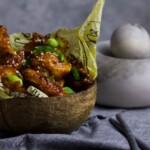 Keto Crispy Chicken Wings in a coconut bowl on grey cloth