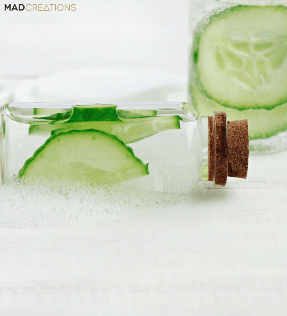 Bottle of water with cucumber slices in them