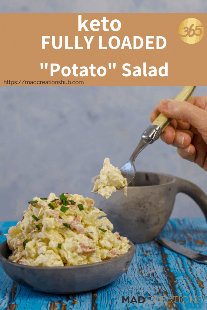 A fork with cauliflower salad on it