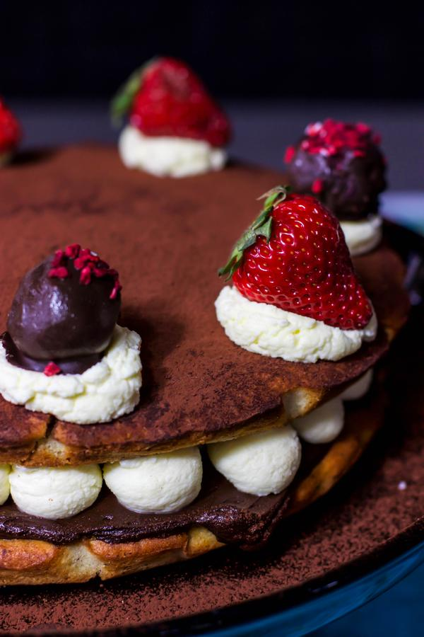Tiramisu chocolate cake with strawberries on top