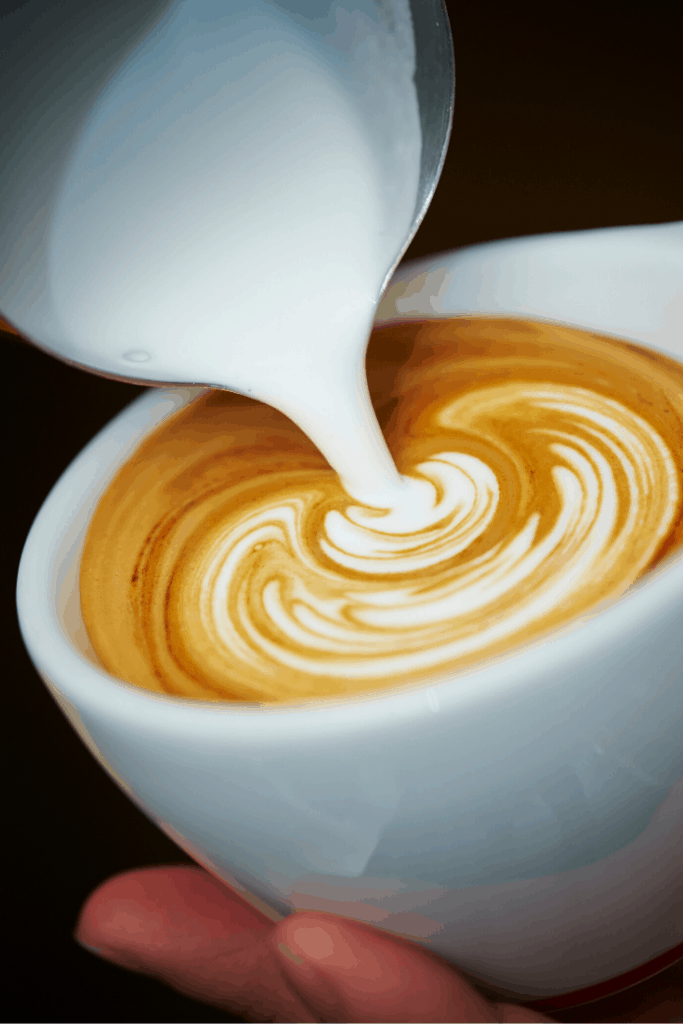 milk pouring into coffee