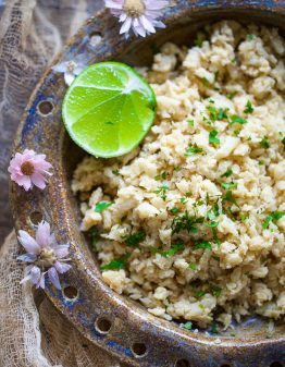 Cauliflower rice and lime in a brown bowl