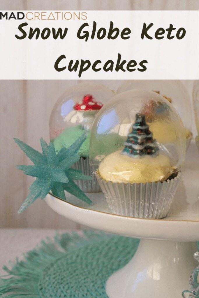 Snow globe cupcake on white cake stand