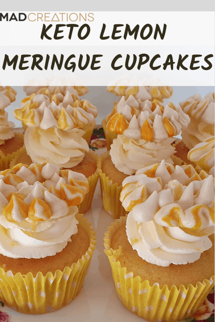 Keto lemon meringue cupcakes on a cake stand
