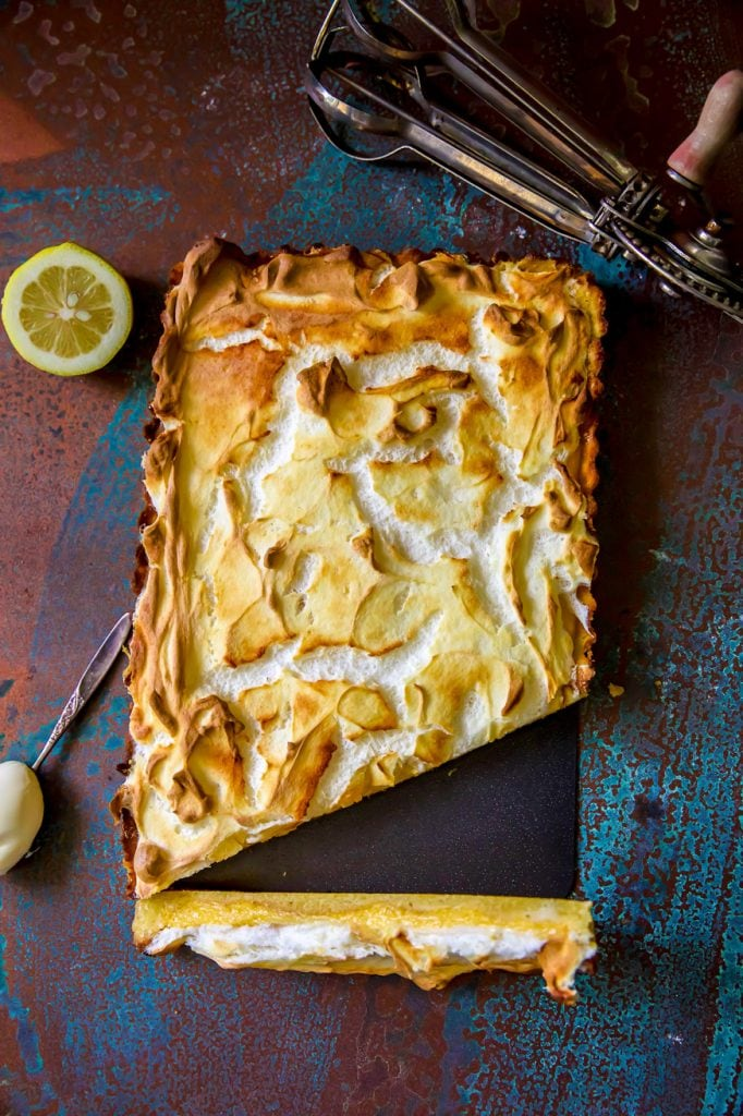 Lemon meringue pie on copper background