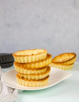 Keto Pie Crusts on a white plate with a blue table
