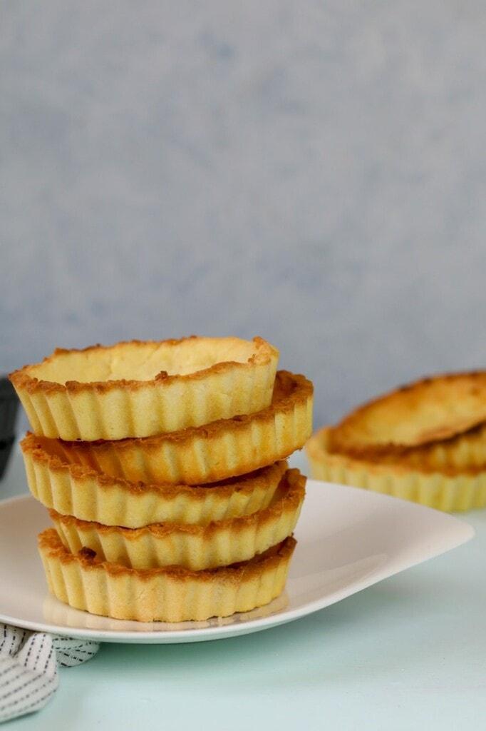 Keto Lemon Meringue Pie Crusts stacked on top of each other