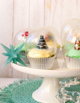 Snow Globe Cupcakes on white cake stand