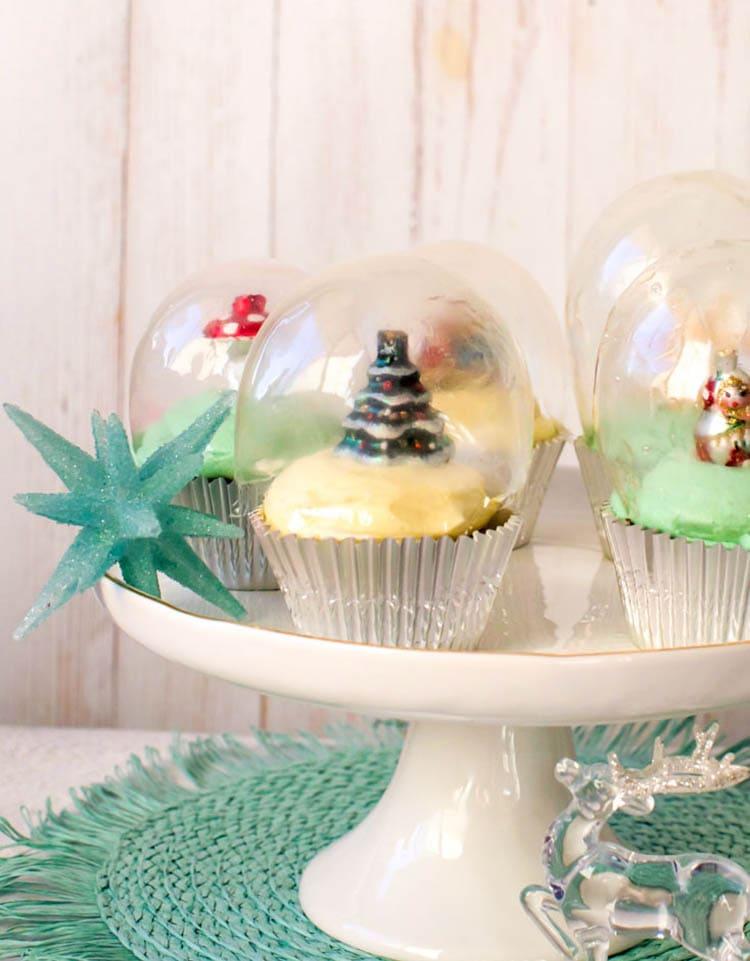 Snow Globe Cupcakes on white cake stand