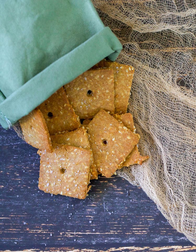 keto crackers in a green bag on a wood table