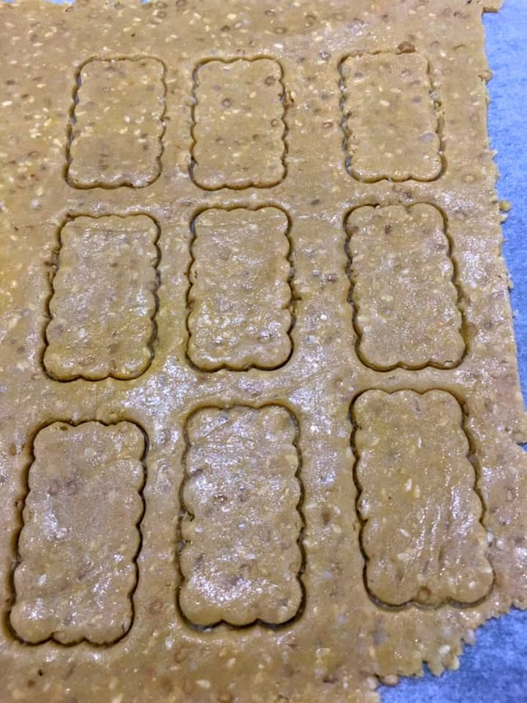 Cutting the keto sesame crackers with a cookie cutter