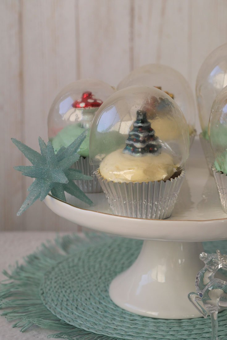 Snow globe cupcake in a cake platter