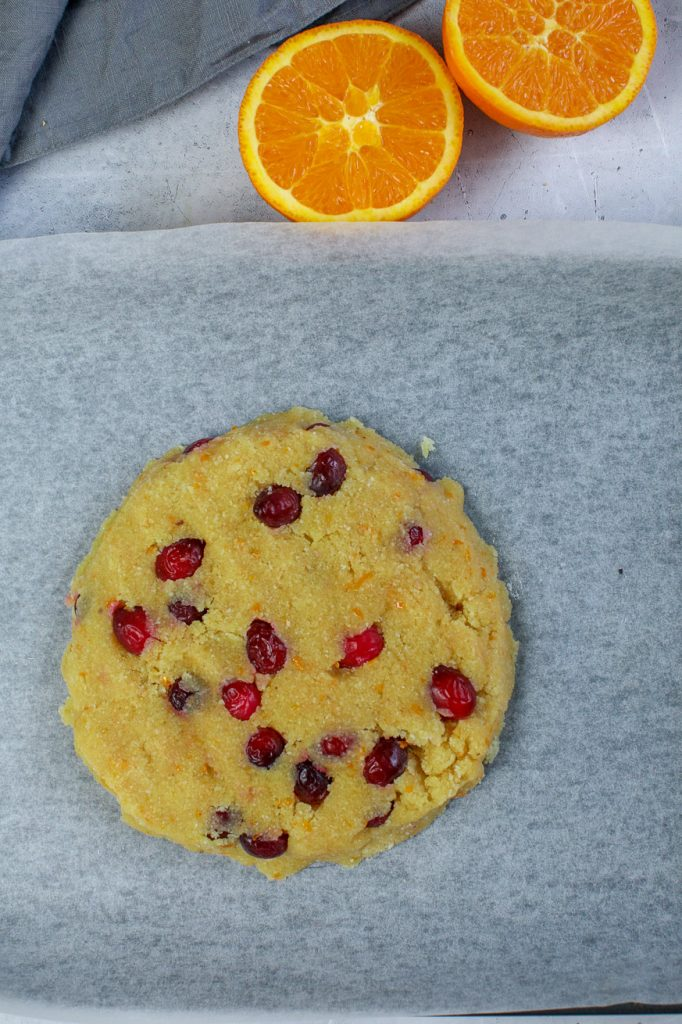 round of cranberry orange scone dough on baking paper