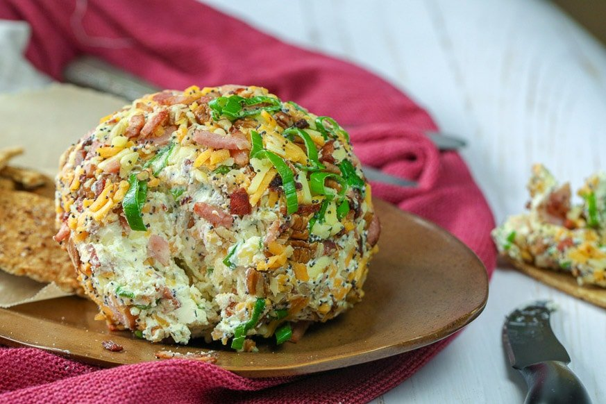 close up of cheese ball with piece out of it