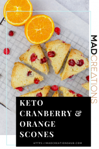 Keto orange cranberry scones on a wire rack with cranberries scattered