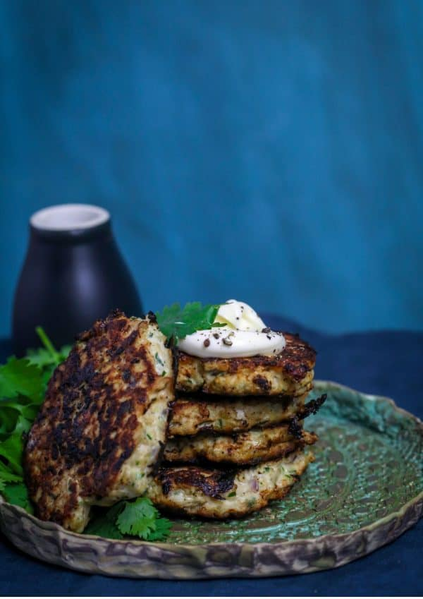 a stack of fritters on a green background
