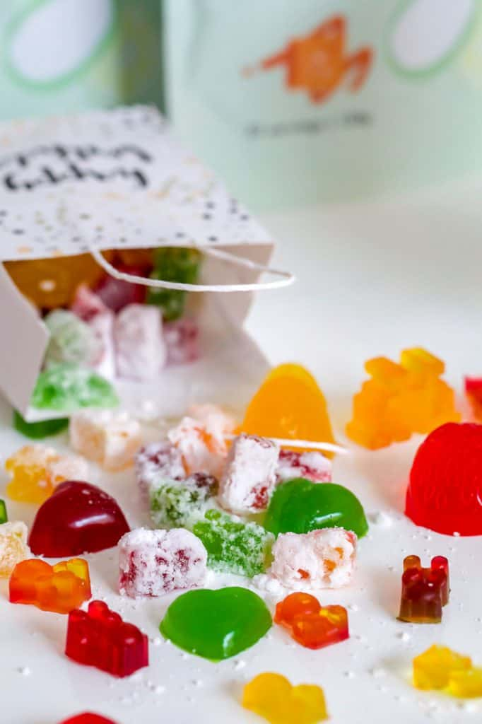 a bag of lollies upturned with the lollies spilling out