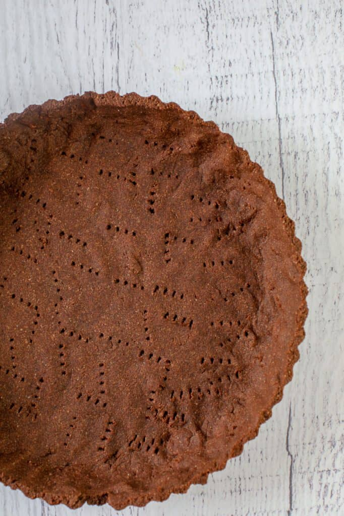 chocolate pie crust on white table