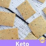 keto cheese crackers scattered on white wood