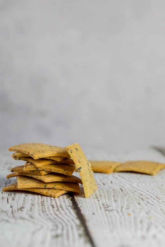 Ranch Crackers in a stack on a white wood table