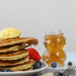 pancakes on a white plate with berries