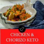 bowl of chorizo paella with knitted blue towel