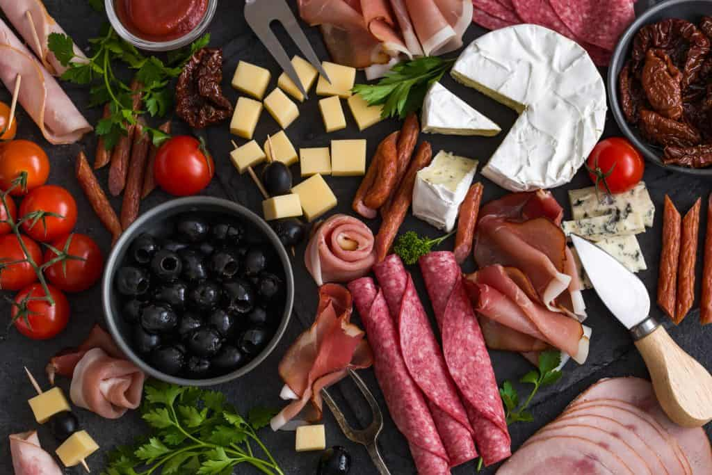 anitpasta platter with cheese, meats and olives
