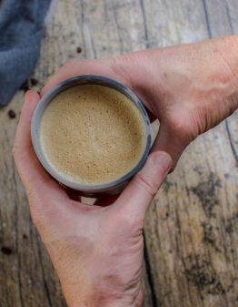a coffee between two hands
