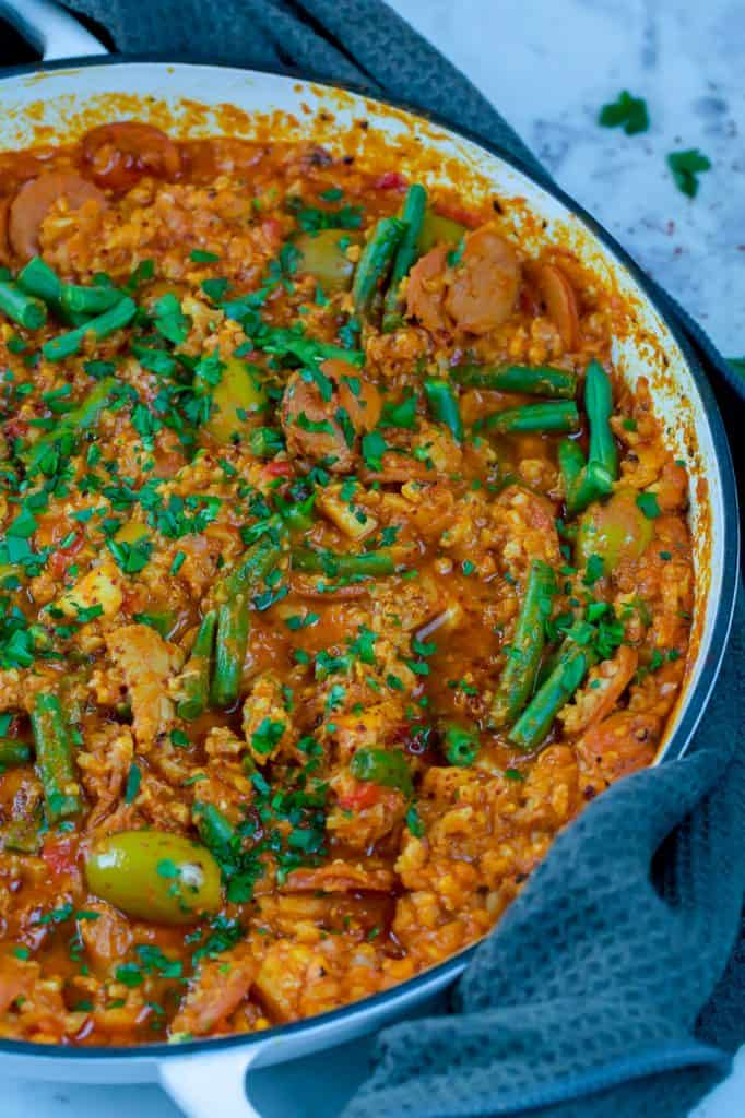 skillet filled with paella and green beans