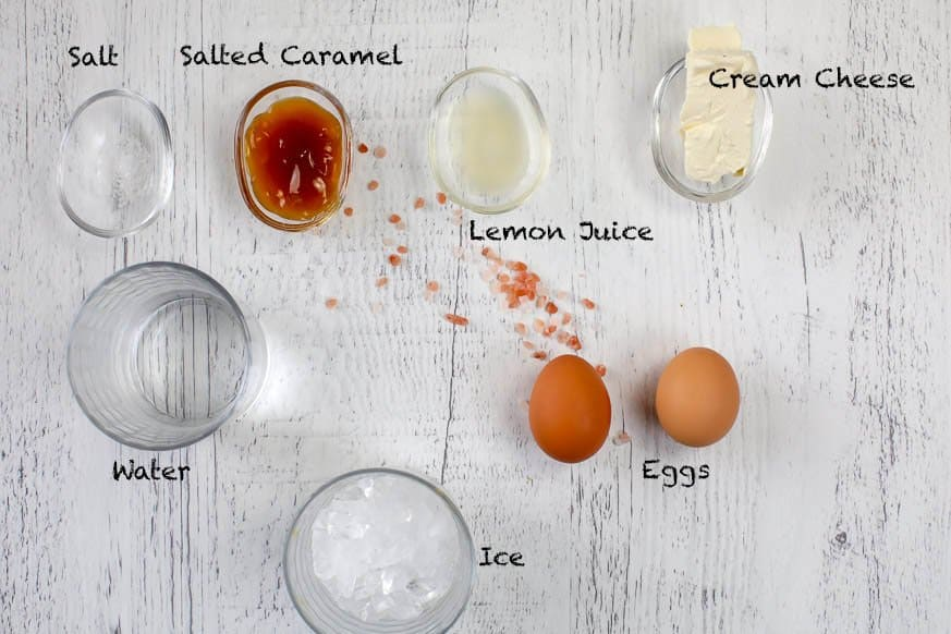 ingredients for an egg shake on a white wood table